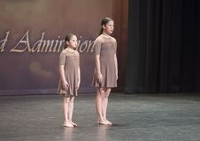 Amerasian sisters perform jazz duet. Pictured are a thirteen year old and nine year old Amerasian sisters performing a jazz duet in a dance competition.  They Royalty Free Stock Images