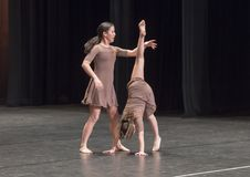 Amerasian sisters perform jazz duet. Pictured are a thirteen year old and nine year old Amerasian sisters performing a jazz duet in a dance competition.  They Royalty Free Stock Photography