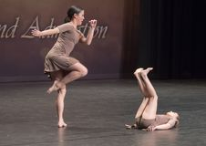 Amerasian sisters perform jazz duet. Pictured are a thirteen year old and nine year old Amerasian sisters performing a jazz duet in a dance competition.  They Royalty Free Stock Image