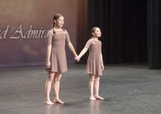 Amerasian sisters perform jazz duet. Pictured are a thirteen year old and nine year old Amerasian sisters performing a jazz duet in a dance competition.  They Royalty Free Stock Photos