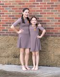 Amerasian sisters posing after their jazz duet, Dance competition royalty free stock photo