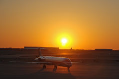 Amercan Airlines Jumbo Jet at Sunset. Amercan airlines jet starting at sunset. there are always news about big companies and the business of flying. For example stock image