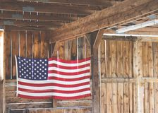 Amercian Flag on Brown Wooden Wall during Daytime Stock Photo