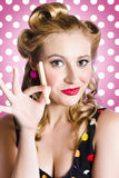 Amercian pinup girl with laundry peg Stock Photos
