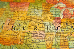 America. Close up of the word America taken from an old map on a globe royalty free stock images