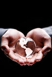 America continent. Hands holding a glass globe showing America continent Royalty Free Stock Photography