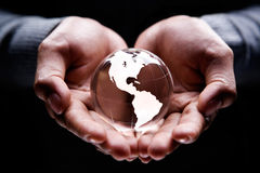 America continent. Hands holding a glass globe showing America continent Stock Photo