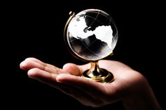 America continent. Single hand holding a glass globe showing America continent Royalty Free Stock Images