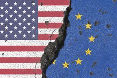 America and Europe rift. Grunge style background of American and European Union flags with gap or rift torn in center Royalty Free Stock Photography