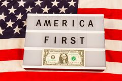 America First Slogan. Lightbox with letters - AMERICA FIRST - on an american national flag Royalty Free Stock Photos
