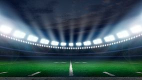 America football stadium. American football field illuminated by stadium lights with copy space stock images
