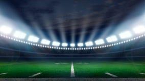 America football stadium. American football field illuminated by stadium lights with copy space Stock Images