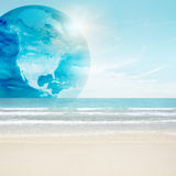America globe on tropical beach Stock Photos