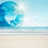 America globe on tropical beach Stock Photos