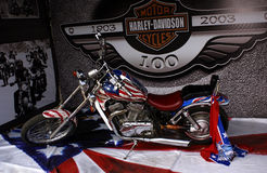 America harley. An american motorcycle over a centenary harley background stock photo