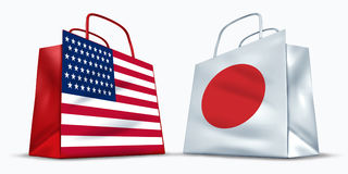 America and Japan trade. Symbol represented by two shopping bags with the American and the Japanese flag with stars stripes and red rising sun showing the Royalty Free Stock Photography