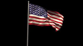 America national flag waving on flagpole Royalty Free Stock Photography