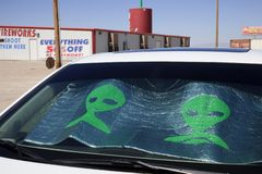 America. Nevada / USA - August 22, 2015: A alien picture on a car windscreen at The Area 51 Alien Center in a gas station in the Nevada desert, Amargosa Valley royalty free stock photos