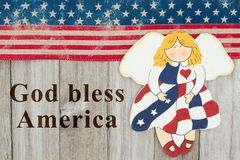 America patriotic message with an angel. America patriotic message, USA patriotic old flag and an angel and weathered wood background with text God Bless America Royalty Free Stock Photo