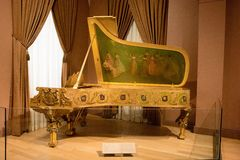 America Receiving the Nine Muses Piano. Hoping to initiate a more active musical life at the White House, President Theodore Roosevelt commissioned Steinway & Royalty Free Stock Images