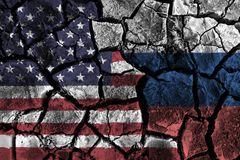 America and Russia flag on cracked ground . Confliction and crisis concept Royalty Free Stock Image