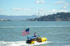 America's Cup Final. Spectator floating by the San Francisco Bay Bridge during the Final America's Cup Race in San Francisco Royalty Free Stock Photos