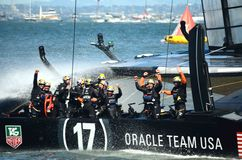 America's Cup Finals. Team Oracle waving their hands in victory after winning the 2013 America's Cup Finals in San Francisco Stock Photo
