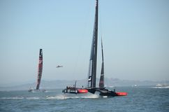 America's Cup 2013. Team Oracle beating Team New Zealand in one of the America's Cup races Royalty Free Stock Image