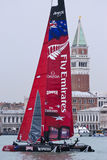 America's cup world series. The san Marco tower and Venice behind one of the catamarans Royalty Free Stock Photos