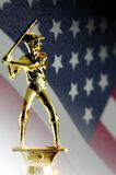 America's pastime. Baseball trophy and American flag Royalty Free Stock Image