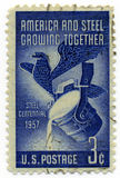 America and Steel 1957 Vintage stamp. America and Steel 1957 3c Vintage stamp isolated over white Royalty Free Stock Image