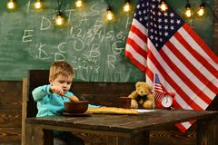 America and usa concept. america with its symbol flag on inpendence day at school with small kid. Royalty Free Stock Photo