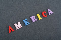 America word on black board background composed from colorful abc alphabet block wooden letters, copy space for ad text Royalty Free Stock Image