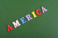 America word on green background composed from colorful abc alphabet block wooden letters, copy space for ad text. Learning english concept royalty free stock photos