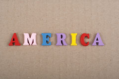 America word on paper background composed from colorful abc alphabet block wooden letters, copy space for ad text Stock Image