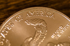 America (word) on US Gold Eagle Coin.  stock photos