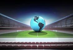 America world globe in midfield of magic football stadium Stock Image
