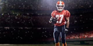 Americam football player. Is holding the ball royalty free stock images