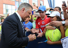 American actor, producer, and comedian Alec Baldwin signing autographs at the red carpet before US Open 2015 Royalty Free Stock Images