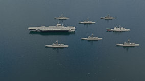 American Aircraft Carrier with destroyers and a cruiser in the Pacific Ocean towards North Koreaì. American Aircraft Carrier with destroyers and a cruiser in Stock Photography