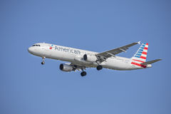 American Airlines Airbus A321. An American Airlines airbus A321 is set to make a landing, with it`s landing gear on Royalty Free Stock Photo