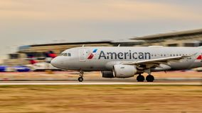 American Airlines Airbus A320 taking off. December 16th, 2018, American Airlines Airbus A320 taking off with background motion blur stock photos