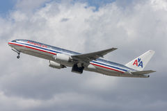 American Airlines Boeing 777 airplane taking off from Los Angeles International Airport. Stock Photo