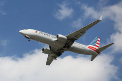 American Airlines Boeing 737 descending for landing at JFK International Airport in New York. NEW YORK - AUGUST 13, 2015: American Airlines Boeing 737 descending Stock Photo