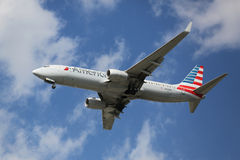 American Airlines Boeing 737 descending for landing at JFK International Airport in New York. NEW YORK - AUGUST 13, 2015: American Airlines Boeing 737 descending Royalty Free Stock Photos