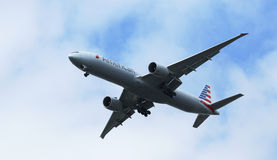 American Airlines Boeing 777 in New York sky before landing at JFK Airport Stock Photo