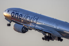 American Airlines Boeing 777 Oneworld Livery taking off from Los Angeles International Airport. Stock Image