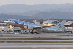 American Airlines Boeing 777 Oneworld Livery taking off from Los Angeles International Airport. Stock Photos