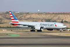 American airlines Boeing 777-200 taxiing at Madrid Barajas Adolfo Suarez airport. Madrid, Spain - August 12 2015: American airlines Boeing 777-200 taxiing at Stock Photo