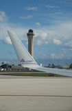 American Airlines plane and Air Traffic Control Tower at Miami International Airport. MIAMI, FLORIDA - JUNE 1, 2016: American Airlines plane and Air Traffic Stock Image